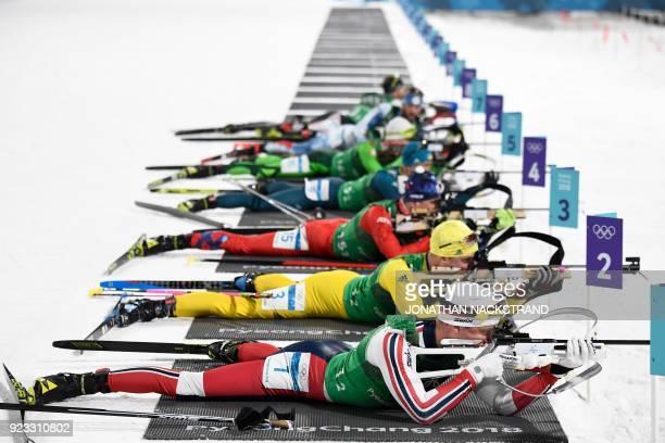 TOPSHOT Norway's Tarjei Boe Sweden's Jesper Nelin Slovakia's Tomas Hasilla and Ukraine's Sergii Semenov compete at the shooting range in the men's...