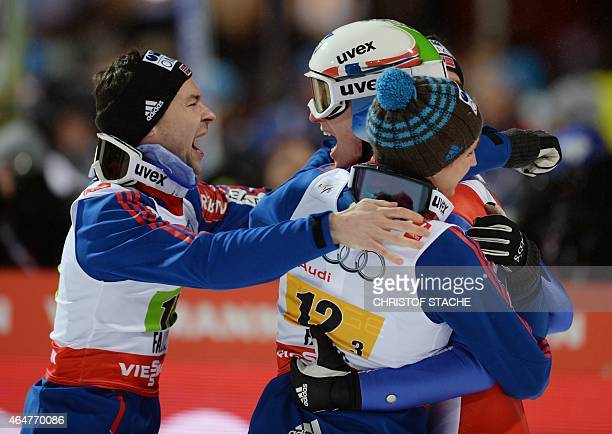 Norway's team Anders Jacobsen Rune Velta Anders Fannemel and Anders Bardal celebrate after competing at the Men Large Hill Team competition of the...