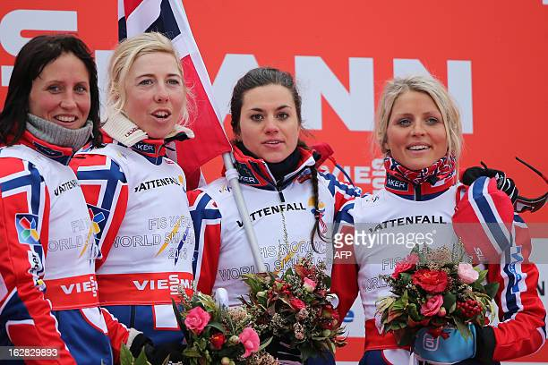 Norway's team Marit Bjoergen Kristin Stoermer Steira Hiedi Weng and Therese Johaug pose on February 28 2013 on the podium after winning the Women's...