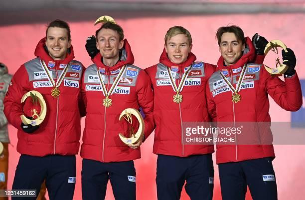 Norway's team, Norway's Joergen Graabak, Norway's Espen Bjoernstad, Norway's Jens Luraas Oftebro and Norway's Jarl Magnus Riiber pose with their gold...