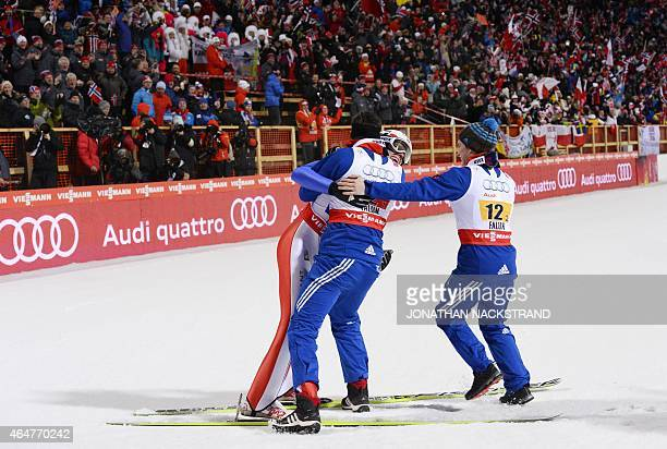 Norway's team Rune Velta Anders Bardal and Anders Fannemel celebrate after the Men Large Hill Team competition of the 2015 FIS Nordic World Ski...
