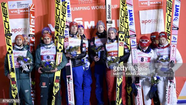 Norway's Team who arrived first Robert Johansson Anders Fannemel Daniel Andre Tande and Johann Andre Forfang German tam second placed Markus...