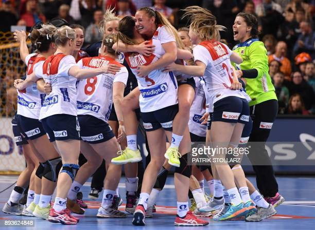 TOPSHOT Norway´s teamplayers celebrate after they won the IHF Womens World Championship handball halffinal match between Norway and Netherlands on...