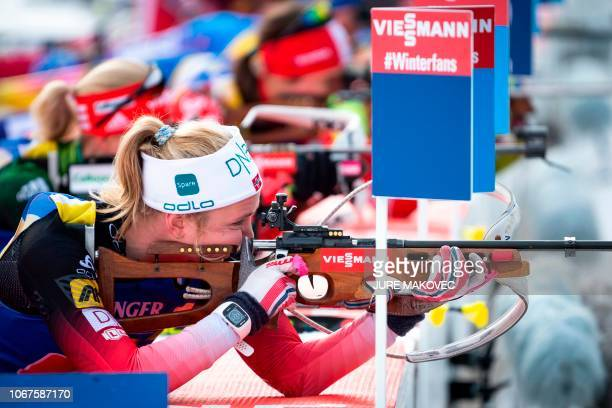 Norway's Thekla BrunLie competes at the shooting range during the Single Mixed Relay competition of the IBU Biathlon World Cup in Pokljuka on...