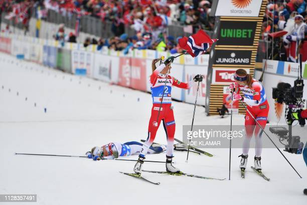 Norway's Therese Johaug and Norway's Ingvild Flugstad Oestberg celebrate as third placed Sweden's Frida Karlsson lies behind on the snow after the...