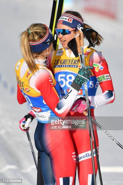 Norway's Therese Johaug and Norway's Ingvild Flugstad Oestberg react at the end of the Ladies' 10km crosscountry event at the FIS Nordic World Ski...