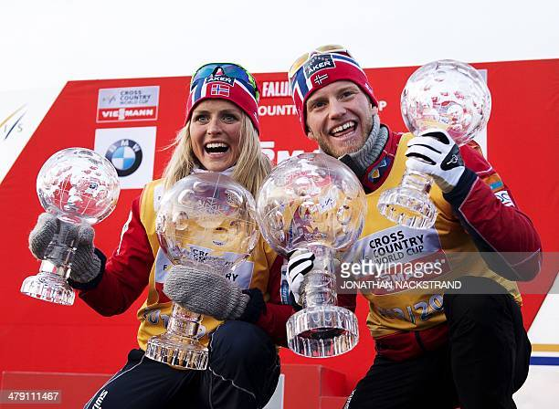 Norway's Therese Johaug and Norway's Martin Johnsrud Sundby pose with their overall World Cup trophies during the winners presentation at the FIS...