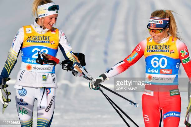 Norway's Therese Johaug and Sweden's Frida Karlsson react after the Ladies' 10km crosscountry event at the FIS Nordic World Ski Championships on...