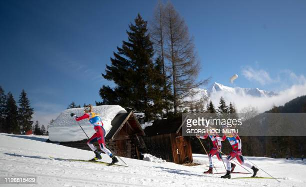 Norway's Therese Johaug Astrid Uhrenholdt Jacobsen and Ingvild Flugstad Oestberg compete in the Women's 15km crosscountry skiathlon event at the FIS...