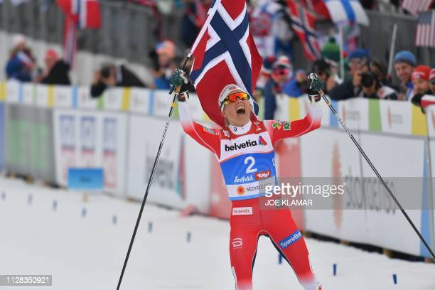 Norway's Therese Johaug celebrates after the CrossCountry Ladies 30km Mass Start Free event at the FIS Nordic World Ski Championships on February 28...