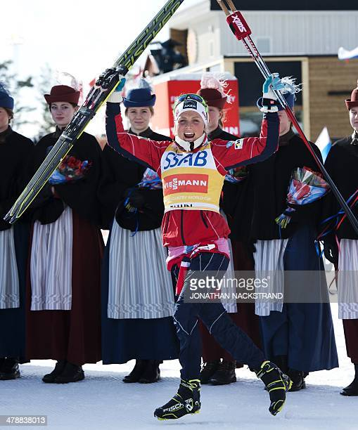 Norway's Therese Johaug celebrates during the FIS CrossCountry World Cup Ladies Skiathlon 75 classic and 75 km free winner's ceremony in Falun Sweden...