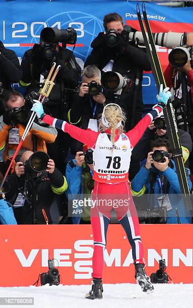 Norway's Therese Johaug celebrates first place in front of photographers during the Women's Cross Country skiing 10 Km Free Individual of the FIS...