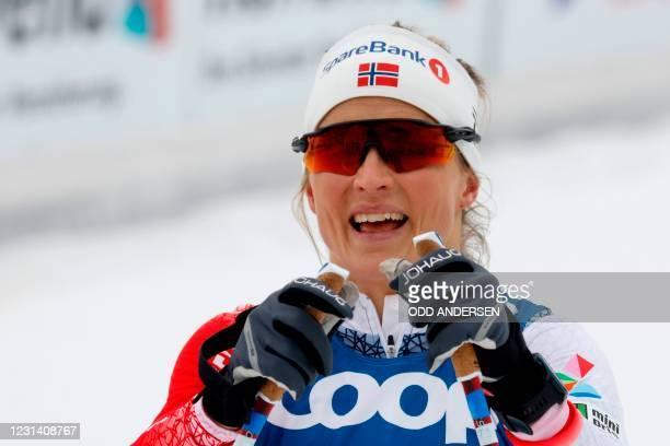 Norway's Therese Johaug celebrates winning the Women's Skiathlon 2x7,5km event at the FIS Nordic Ski World Championships in Oberstdorf, southern...