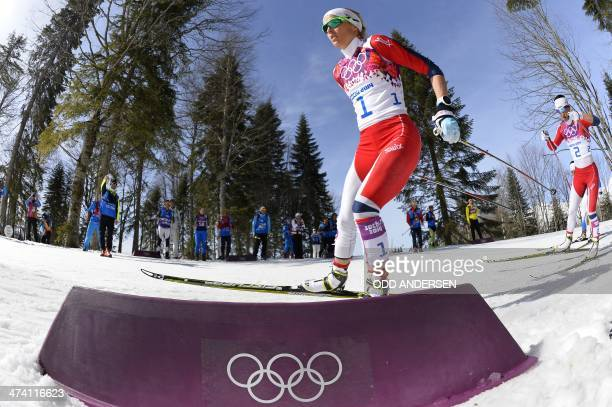 Norway's Therese Johaug competes in the Women's CrossCountry Skiing 30km Mass Start Free at the Laura CrossCountry Ski and Biathlon Center during the...
