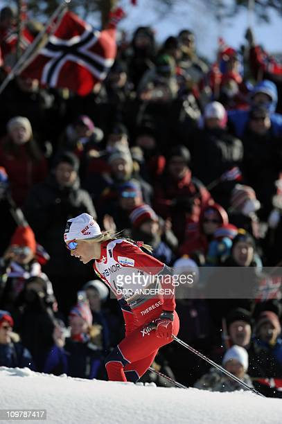 Norway's Therese Johaug competes on March 5 2011 to win the women's freestyle nordic skiing 30km mass start for women at the Nordic Skiing World...