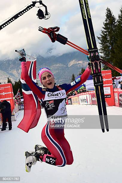 TOPSHOT Norway's Therese Johaug jumps as she celebrates in the finish area after winning the Women's 9 km Climb Pursuit of the FIS World Cup Tour de...
