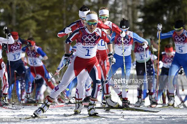 Norway's Therese Johaug leads the pack as she competes in the Women's CrossCountry Skiing 30km Mass Start Free at the Laura CrossCountry Ski and...