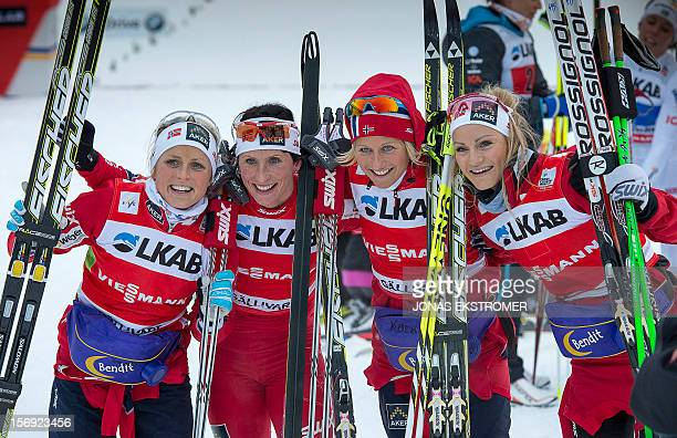 Norway's Therese Johaug Marit Bjoergen Vibeke Skofterud and Martine Ek Hagen pose for photographers after winning the Ladies 4 x 5 km Classic/Free...