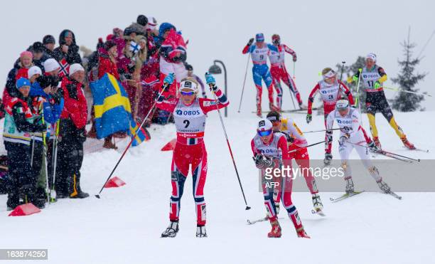 Norway's Therese Johaug Norway's Heidi Weng and Poland's Justyna Kowalczyk compete during the ladies Holmenkollen Cross Country 30 km freestyle mass...