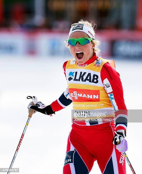 Norway's Therese Johaug reacts as she skis to the finish line of the FIS CrossCountry World Cup Ladies 10 km F Pursuit in Falun on March 16 2014...