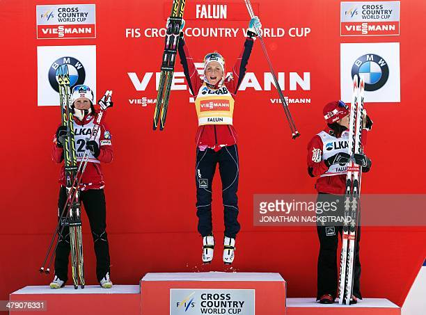 Norway's Therese Johaug reacts next to second place Norway's Marit Bjoergen and third place Norway's Heidi Weng during the FIS CrossCountry World Cup...