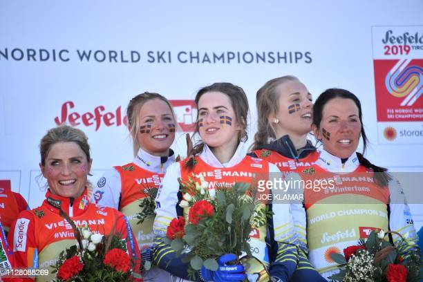 Norway's Therese Johaug stands next to winners Sweden's Ebba Andersson Sweden's Frida Karlsson Sweden's Charlotte Kalla and Sweden's Stina Nilsson on...