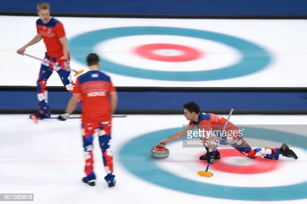 Norway's Thomas Ulsrud throws the stone during the curling men's round robin session between Norway and Italy during the Pyeongchang 2018 Winter...