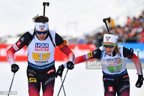 Norway's Tiril Eckhoff passes a relay to Norway's Tarjei Boe during the IBU Biathlon World Cup 4x6 Mixed Relay in RasenAntholz Italian Alps on...