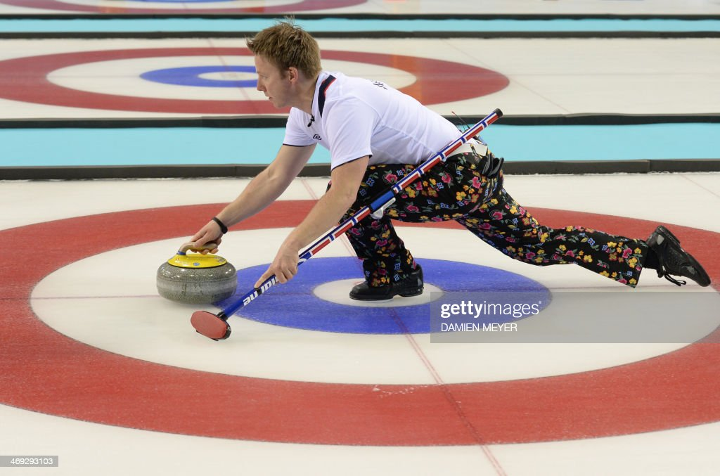 Norway's Torger Nergaard throws the stone during the Men's Curling Round Robin Session 7 at the Ice Cube Curling Center during the Sochi Winter Olympics on February 14, 2014.