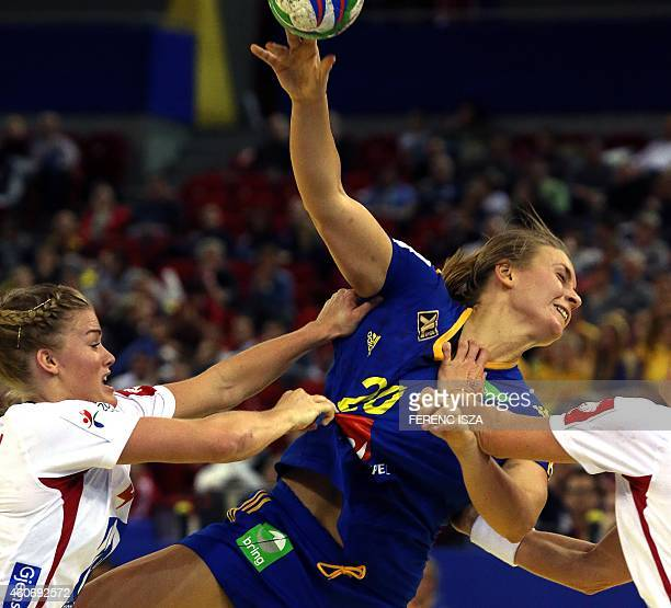 """Norway's Veronica Kristiansen fights for the ball with Sweeden's Isabelle Gullden in """"Papp Laszlo"""" hall of Budapest on December 19, 2014 during the..."""