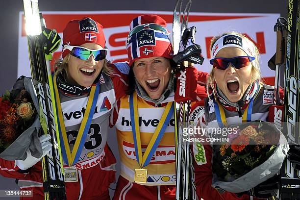 Norway's Vibeke Skofterud Marit Bjoergen and Therese Johaug react during the podium ceremony of the women's nordic skiing FIS Crosscountry World Cup...
