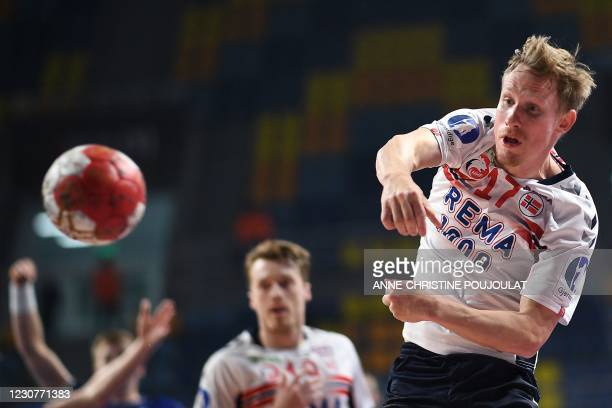 Norway's wing Magnus Jondal shoots during the 2021 World Men's Handball Championship match between Group III teams Iceland and Norway at the 6th of...