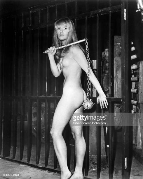 Norwegian actress Julie Ege naked and carrying a spiked flail circa 1970