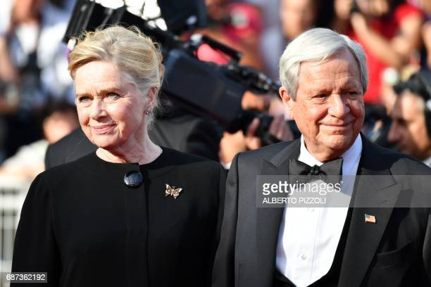 Norwegian actress Liv Ullmann and Donald Saunders pose as they arrive on May 23 2017 for the '70th Anniversary' ceremony of the Cannes Film Festival...