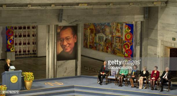 Norwegian actress Liv Ullmann reads Liu Xiaobo's text 'I have no enemies' next to the The Nobel Peace Prize committee from left Thorbjoern Jagland...