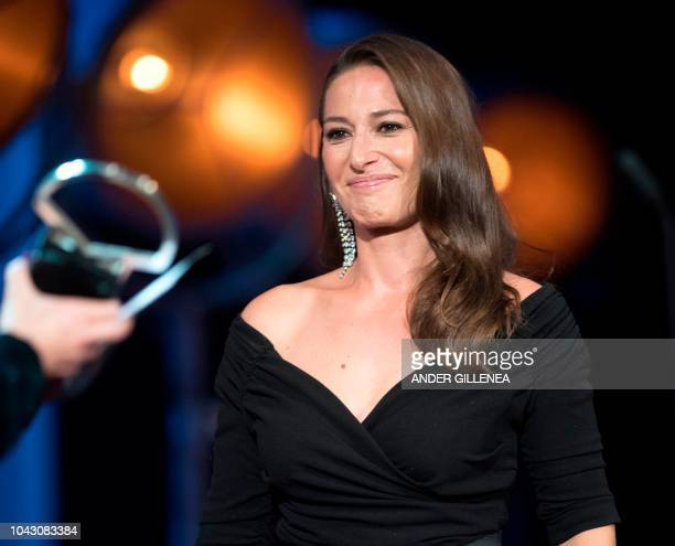 Norwegian actress Pia Tjelta receives the 'Concha de Plata' best actress award for her role in the film 'Blind spot' during the 66th San Sebastian...