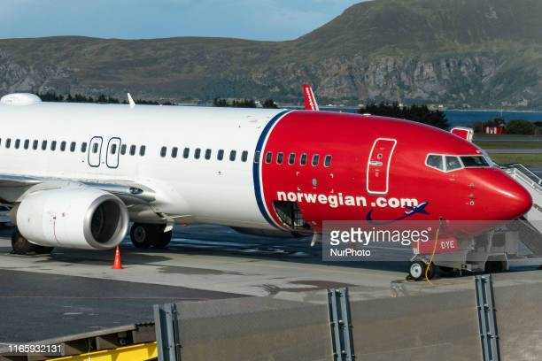 Norwegian Air Shuttle Boeing 737-800 aircraft with registration LN-DYE as seen with passengers boarding on the airplane for departure at Ålesund...