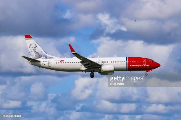 A Norwegian Air Shuttle Boeing 737800 landing at Amsterdam Schiphol International Airport the Netherlands Norwegian is a low cost carrier airline and...