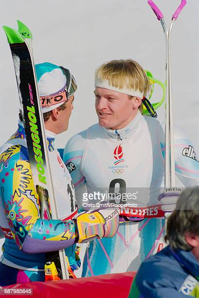 Norwegian alpine skier Finn Christian Jagge is congratulated by 2nd placed silver medal winning Italian alpine skier Alberto Tomba after finishing in...