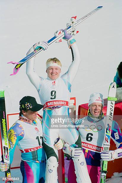 Norwegian alpine skier Finn Christian Jagge is held aloft by 2nd placed silver medal winning Italian alpine skier Alberto Tomba and third placed...