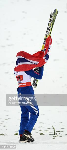 Norwegian Anders Bardal walks with the Norwegian flag on his ski after the Men Large Hill Team competition of the 2015 FIS Nordic World Ski...