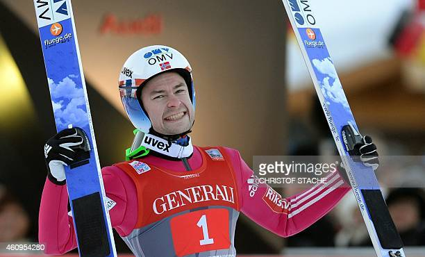 Norwegian Anders Jacobsen celebrates after his second competition jump of the second session of the FourHills Ski jumping tournament in...