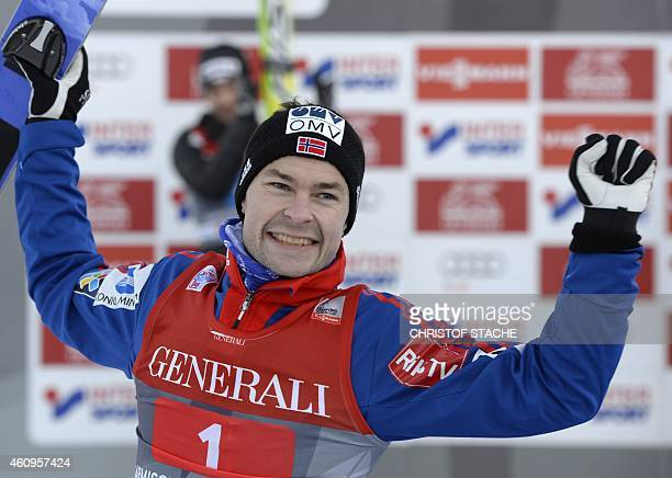 Norwegian Anders Jacobsen celebrates during the winner ceremony of the second session of the FourHills Ski jumping tournament in...