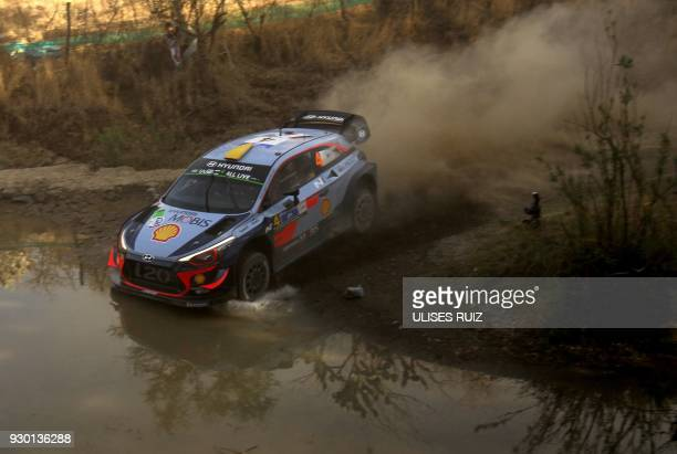 Norwegian Andreas Mikkelsen and codriver Anders JaegerSynnevaag steers their Hyundai i20 Coupe WRC during the second day of the 2018 FIA World Rally...