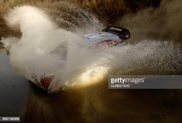 Norwegian Andreas Mikkelsen and codriver Anders JaegerSynnevaag steer their Hyundai i20 Coupe WRC during the second day of the 2018 FIA World Rally...