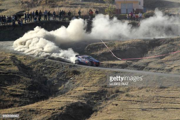 Norwegian Andreas Mikkelsen and codriver Anders JaegerSynnevaag steer their Hyundai i20 Coupe WRC during the final day of the 2018 FIA World Rally...