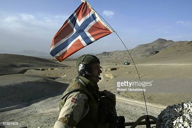 A Norwegian Army soldier and Public Affairs Officer under ISAF command rides in a armored personnel carrier in the western sector of Kabul...