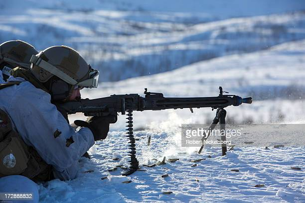Norwegian army soldier fires an automatic weapon at a target March 6 2013 in a live fire exercise in Skjold Norway north of the Arctic Circle White...