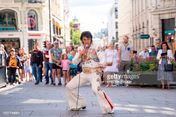 TOPSHOT Norwegian artist Kjell Elvis performs in central Oslo in an attempt to beat the record of the world´s longest Elvis Presley singing marathon...