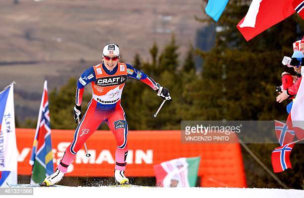 Norwegian athlete Marit Bjoergen crosses the finish line to win the Women's 9 km Pursuit competition of the Tour de Ski Cross Country World Cup on...